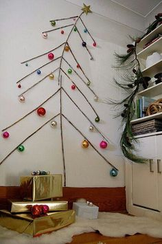 sticks attached to the wall and ornaments hanging on them Wall Christmas Tree, Unique Christmas Trees, Alternative Christmas Tree, Noel Christmas, Xmas Tree, Simple Christmas, Winter Christmas, Christmas Crafts, Christmas Ornaments