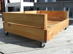 Dog bed made from wood slats