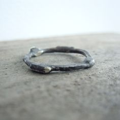 18 gauge recycled sterling silver wire has been fused, filed and hammered to create this gorgeous, textured, stackable ring.  Left with its oxidised patina, this piece will perfectly accent any set of rings.  Choose your size from the drop down.  If your size is not listed then please let me kn...