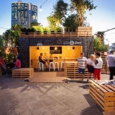 Australian design firm HASSELLs Urban Coffee Farm consists of more than 120 coffee plants, shipping containers – housing the 'Brew Bar' – and timber pallets in Melbourne.