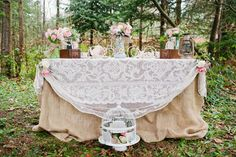 I like the lace draped over the table! And all the cute decor...teapot, antique jewelry box, lantern.