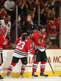 CHICAGO, IL - SEPTEMBER 17: Teuvo Teravainen #23 and Patrick Sharp #10 of the Chicago Blackhawks celebrate Sharp's second period goal agains...