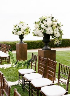 Elegant arrangements define the entrance to the outdoor ceremony.