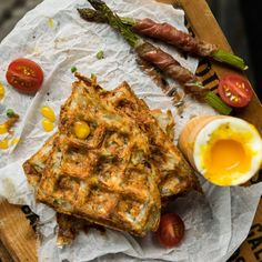 Hashbrown waffles with prosciutto wrapped asparagus and soft boiled eggs.  The perfect brunch!