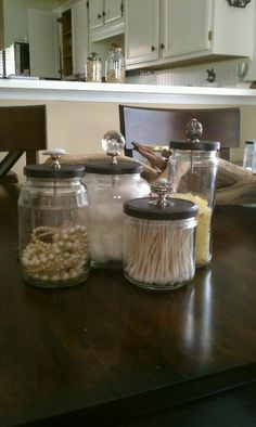 Recycled jars...sand and spray paint lids, and add a decorative knob...set of decorative canisters Find me on Etsy: LuckyinLovewithLuke