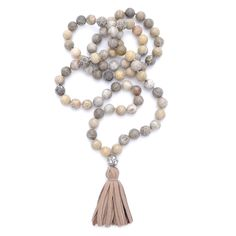 Hand knotted 10mm round fossilized Coral with an oxidized silver rose cut diamond ball and a taupe leather tassel Continue reading →