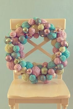 yarn-ball and ornament wreath.