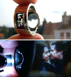 """In a darkened room, shine a light through this incredible one-of-a-kind ring by Luke Jerram and jeweler Tamrakar and it will project a selection of miniature slides onto a surface like a wall or a piece of paper. Jerram, who created it as a wedding ring for his own wife, explains, """"The ring was my first prototype and was made by hacking apart disposal cameras to find the right lens I needed."""""""