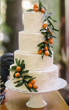 I love this idea! Garnish a simple white tiered wedding cake with colorful fruit... Lovely for the simple beach theme wedding