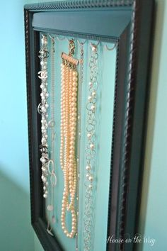 Diy Crafts Ideas : DIY jewelry holder made with an empty picture frame and cup hooks.
