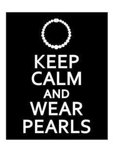 A classy lady wears pearls.