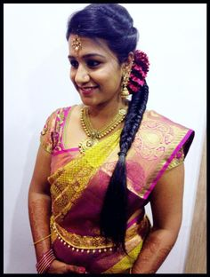 Indian bride's reception hairstyle created by Swank Studio. fishtail braid