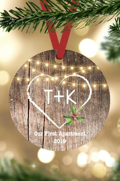 Personalized Our first Christmas Engaged Ornament. A wonderful keepsake gift for any couple! Each ornament comes ready to hang with a red ribbon hanger. Made from durable aluminum which wont break, bend, crack, fade or peel. This rustic aluminum ornament features your names on a faux wood