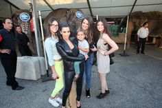 """Kendall Jenner, Kim Kardashian, holding Mason Disick, Khloe Kardashian and Kylie Jenner, the Kardashian family meets one of the pachyderm stars of the Greatest Show On Earth at Ringling Bros. and Barnum & Bailey presents """"Dragons"""" at the Staples Center July 16, 2012"""