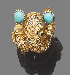 A turquoise dress ring, by Lalaounis  Of bombé scrolling design, accented with two oval cabochon turquoises, signed Lalaounis