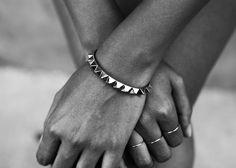The bracelet and skinny rings.
