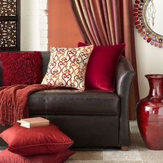 Image result for brown sofa with red accents