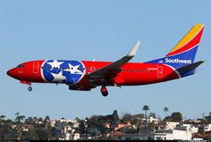 "Southwest Airlines Boeing ""Tennessee One"" on final approach to San Diego-Lindbergh Field, December (Photo: Ighsiao) Southwest Airlines, Military Jets, Commercial Aircraft, Paint Schemes, First Photo, Airplanes, Aviation, Lindbergh, Sky"