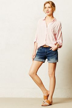 Pilcro Stet Roll-Up Shorts #anthropologie  These shorts are not too short or tight so they convey a relaxed comfortable air without the distraction of too much thigh when seated.  The blouse however is not good when photographed from mid-range. This very loose fit can seem bulky and sloppy. If it were more fitted so you could actually see where her waist and arms are, then it could work well.