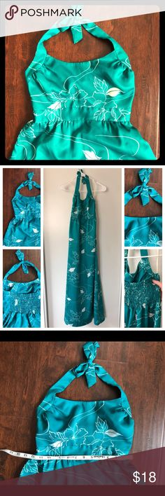 Vintage Teal Blue Hawaiian Floral Maxi Dress In good used vintage condition, but the material has some slight snagging as pictured. The back of the dress is gathered and very stretchy, so it can fit a good range of bust sizes. Labeled size 8, but probably not accurate to modern sizing. The Polynesian Village Dresses Maxi