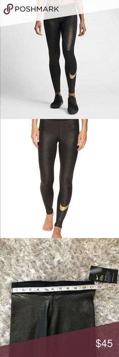 Nike Women's size XS training black gold metallic Nike XS A figure-hugging fit reduces distractions and ensures optimal movement, while the flat elastic waistband helps these tights stay put. A mesh panel at the calf increases airflow, while the triangula