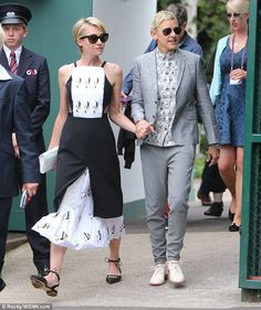 Ellen and Portia: The pair looked stylish, with American presenter Ellen sporting a grey suit, flower-print shirt and sunglasses