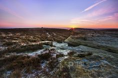 On the edge of the Peak District, sunrise over Sheffield from Burbage Moor