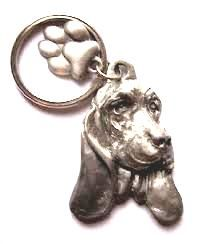 Basset Hound keyring with lovely paw charm, made from finest pewter. U.S manufacturers authentication stamp on reverse. Available in UK - price includes VAT & UK postage.