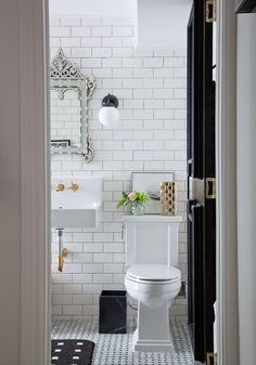 christine dovey bathroom 1 moroccan mirror ikea sconces marble waste basket floating sink brass faucet kohler subway tile dark grout