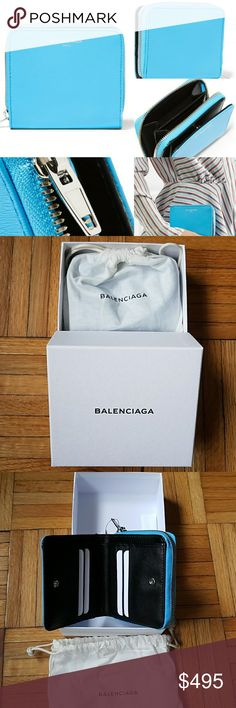 """Balenciaga Azure Blue Textured Leather Wallet New on box and with dust bag! Balenciaga Essential Textured Leather Wallet  -color is azure blue -snap fastening flap, zipper fastening on one side -orgnaized interior with card slots, one bill compartment, coin pouch with zipper  -silver designer lettering on front -made in Italy -4.25"""" length, 4"""" height Balenciaga Bags Wallets"""