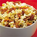 If plain #popcorn is too wimpy for your taste buds, try this mix brimming with flavorful add-ins: unsalted nuts, wasabi peas, pretzels and cheese snacks, all tossed with smoked paprika and garlic and onion powders. #snack