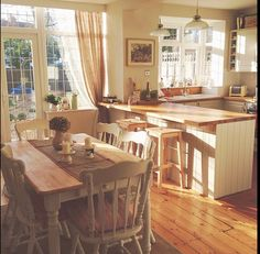 Country style kitchen with cream units. Garden trading pendent lights over the breakfast bar.
