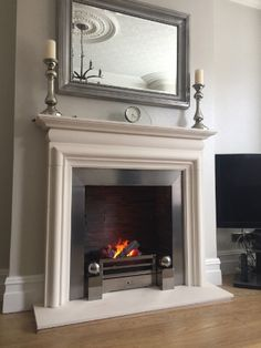 Asquith limestone fireplace with matching hearth, steel slips, oyster slate chamber and a Chesney opti mist basket