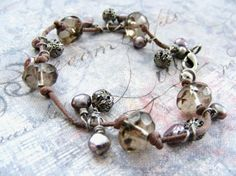 Knotted Cotton Cord and Wire Wrapped Pearls Glass and Gunmetal Beads Bracelet. $19.00, via Etsy.