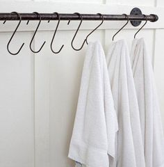 Towel Bar |Bathroom Organization Ideas - Just use the towel rack that's already mounted...  - Then a basket above for rolled wash cloths and hand towels