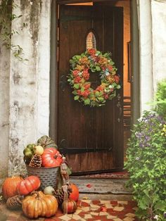 Fill our concrete planter with small pumpkins, gords and pinecones, then arrange larger ones at base of container (include a couple of white pumpkins)