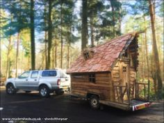 Pixie Cabin - Mark Burton | Built without a spirit level or tape measure, the Pixie Cabin is designed to look like an old falling down house. It's uniquely mobile and is used as a tea room, an office, a place to store tools and to keep dry when it rains. It even contains a log burner to keep warm.