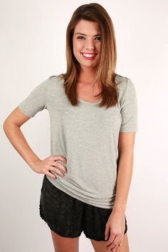 """The """"Fashionable & Fun Top"""" is one of our favorite basics this season! The super soft material and loose fit will make you want this one in every single color! When you don this one, you'll be comfortable and cute whether you pair it with your favorite cutoffs or flowy printed pants!"""