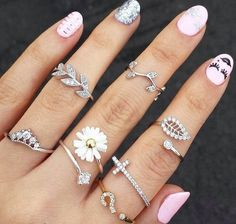 Midfinger rings- love the leaf, cross, and crown one
