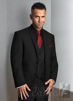 Black shirt and vest, with a red tie. Black and red, best colour ...