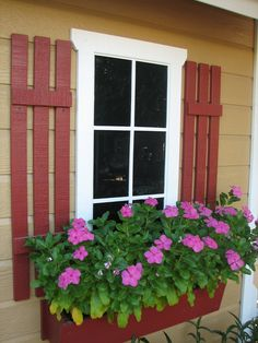 Faux window on shed with vincas in flower box