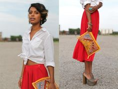 I really like the red-orange contrast against the white blouse, and the colour goes really well with her skin tone,