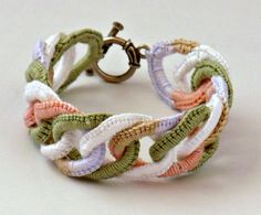 "Handmade Sage White Peach Caramel Wisteria Fine Thread Irish Crochet Faux Chainmail Cadence                                             This is a handmade fine thread Irish crochet faux chainmail bracelet. Made of cotton thread it has 15 sage, white and variegated thread called Cadence (peach, caramel, wisteria) interlocking rings. This bracelet is 1"" wide and 8 1/2"" long, and closes with a toggle clasp."