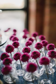 individual bud vase flowers, photo by Megan Saul http://ruffledblog.com/the-notwedding-chicago #weddingideas #flowers