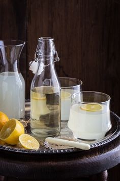 Citrus Rosemary Vodka Spritzer - Citrus Rosemary Infused Vodka (Recipe), Lemonade, Seltzer Water, Lemon Slice.