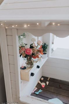 'The planter boxes were filled with beautiful fake flowers (also from Kmart) and then Quinn's café was open for business, brought to life with beautiful wooden signs, stunning florals and beautifully captured by Sarah Fong Photography,' Kristen said Kids Cubby Houses, Kids Cubbies, Play Houses, Girls Playhouse, Playhouse Ideas, Playhouse Decor, Playhouse Outdoor, Playhouse Interior, Kmart Home