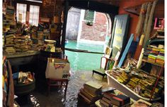 Photos: The 20 coolest bookstores in the world - Libreria Acqua Alta, Venice    The bookstore sits just a few inches above the canal outside.