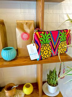 Pineapple and Watermelon imagery handwoven by our Wayuu Tribe in La Guajira, Colombia. To make a single piece can take 3 to 4 weeks. Single Piece, Clutch Bag, Hand Weaving, Handmade Items, Textiles, Red, How To Make, Pink, Pom Poms