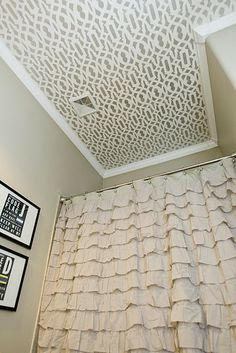 Cool stenciled ceiling in a bath.