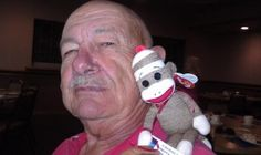 I'd like to wish all the fathers out there a Happy Father's Day. To celebrate Father's Day, I went to the Elk's for the father's day buffet with my parents, and brought my new friend, Sock Monkey. Yesterday, I won Sock Monkey from author Sandra S. Kerns at the Colorado Romance Writers' meeting. Sand